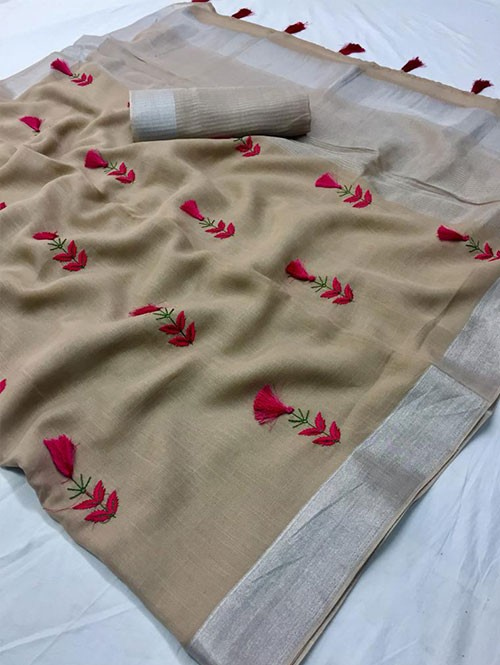Beige Colored Beautiful Embroidered Linen Saree With Tassels