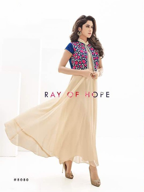 Cream Colored Beautiful Heavy Embroidery Georgette Kurti with Blue jacket.