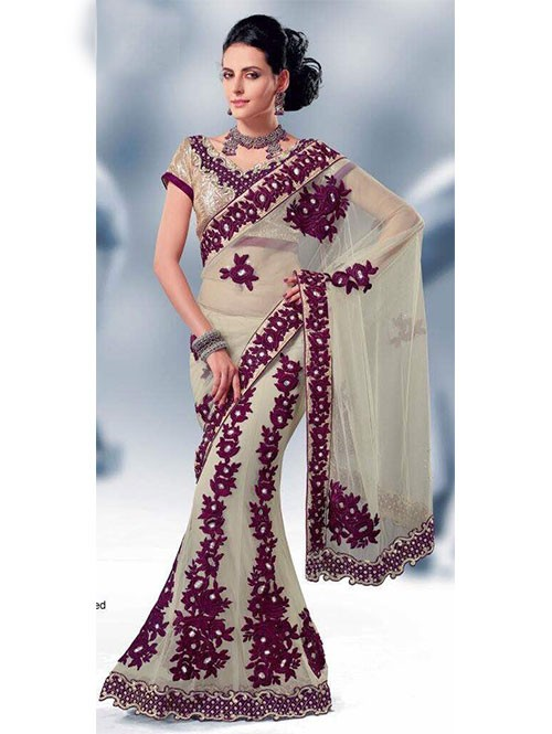Cream Colored Heavy Stone Work and Embroidered Fancy Net Lehenga Saree With satin Inner