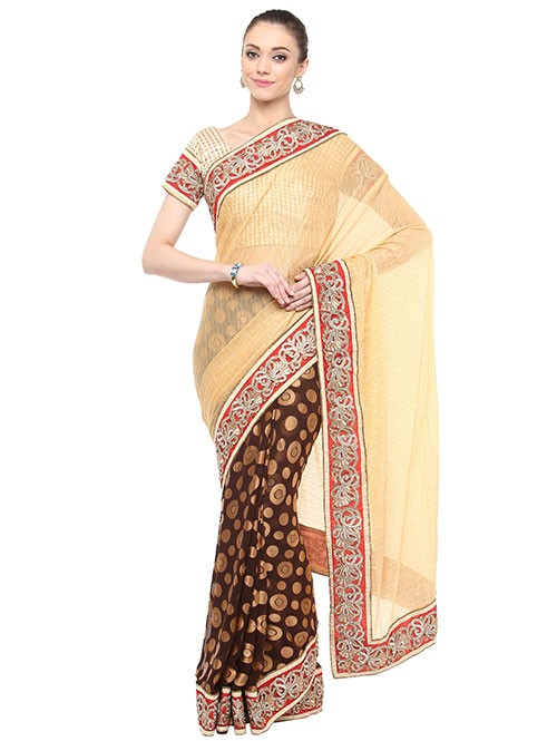 Cream Colored Lycra With Brasso Saree Has Beautiful Embroidered Border.