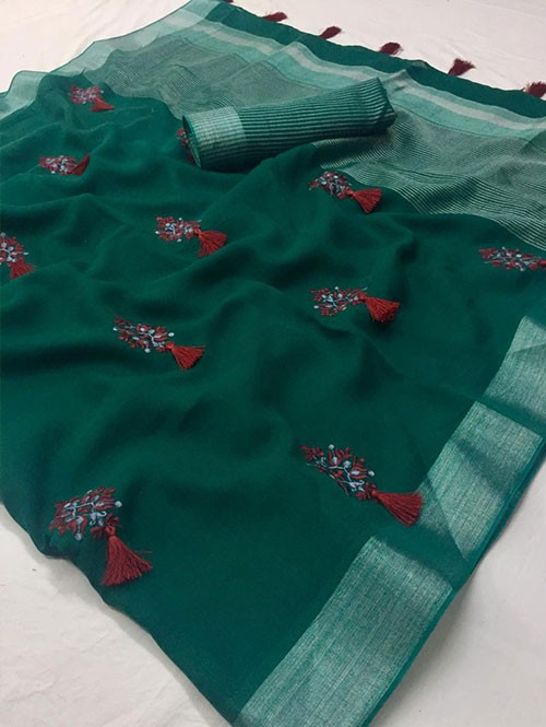 Green Colored Beautiful Embroidered Linen Saree With Tassels