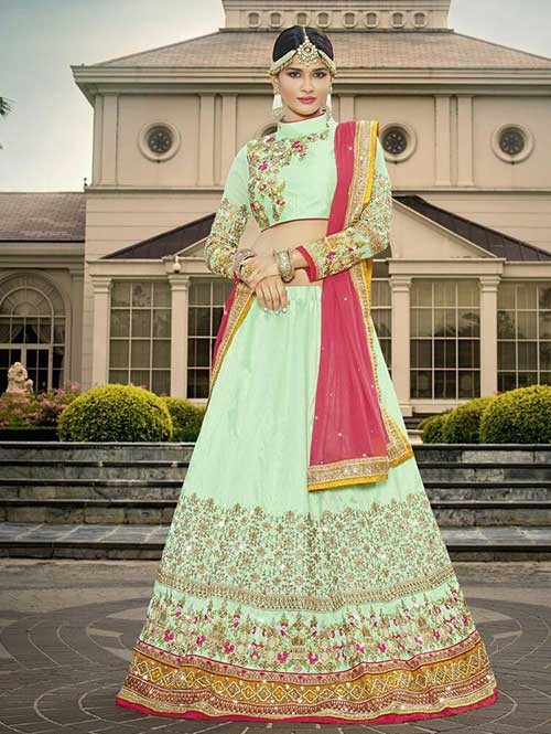 Green Colored Beautiful Heavy Embroidered RawSilk Lehenga Choli