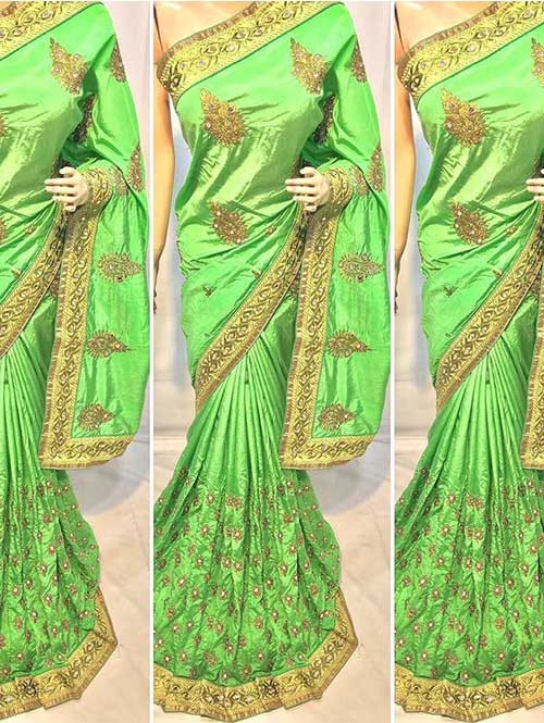 Green Colored Heavy Embroidered Pure silk Saree