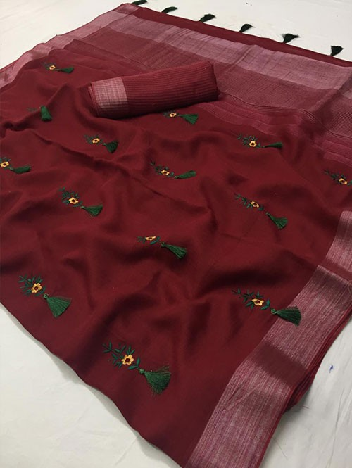 Maroon Colored Beautiful Embroidered Linen Saree With Tassels