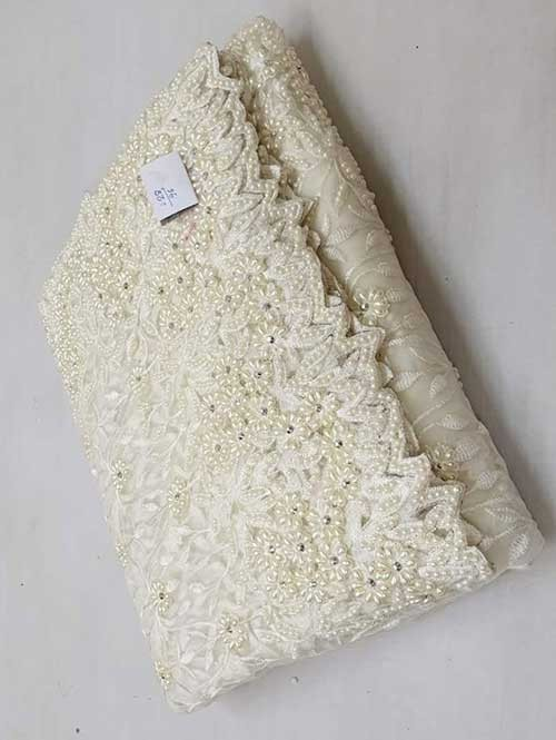 Off White Colored Beautiful Embroidered Net Saree With Dimond work and Pearl work