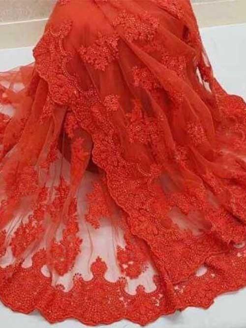 Orange Colored Beautiful Embroidered Net Saree