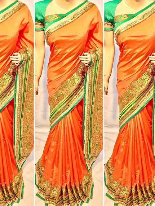 Orange Colored Beautiful Heavy Embroidered Original Saree.
