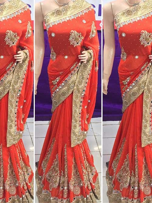 Orange Colored Heavy Embroidered Georgette Saree With Beautiful Mirror-work and Stonework
