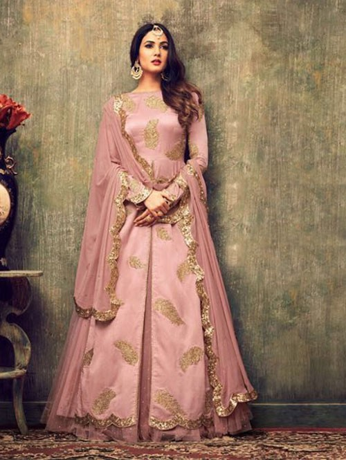 Peach Colored Beautiful Embroidered Heavy Net Salwar Suit