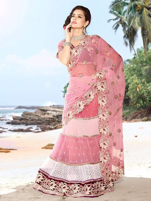 Pink coloured Pure Net Lehenga Saree With Embroidery and Stone Work.