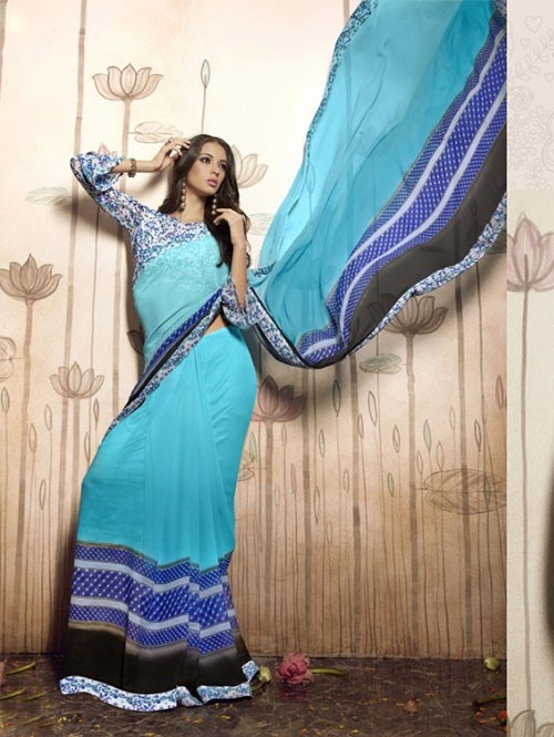Sky Blue Colored Beautiful Faux Georgette Saree with Printed Blouse.