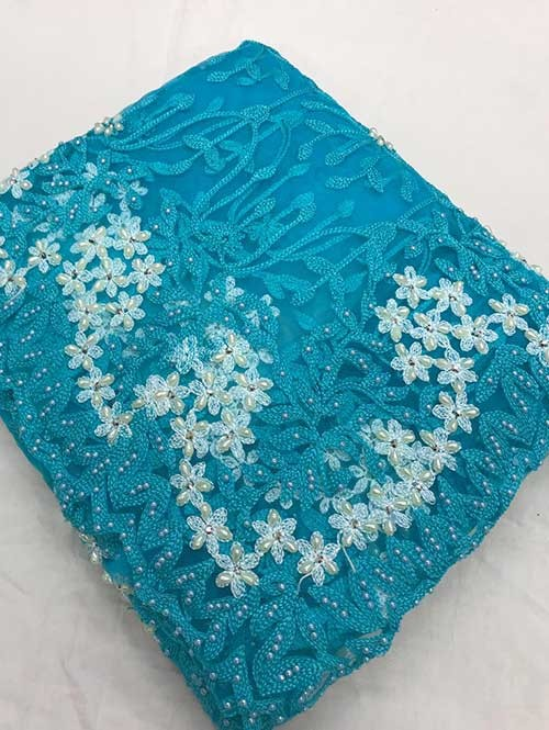 Sky Colored Beautiful Embroidered Net Saree With Dimond work and Pearl wor