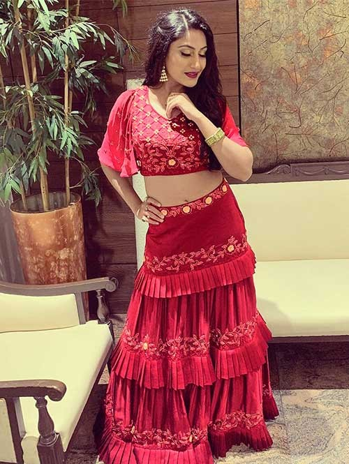 Surbhi Chandna In Maroon Colored Three Layer Lehenga With Beautiful Crop Top