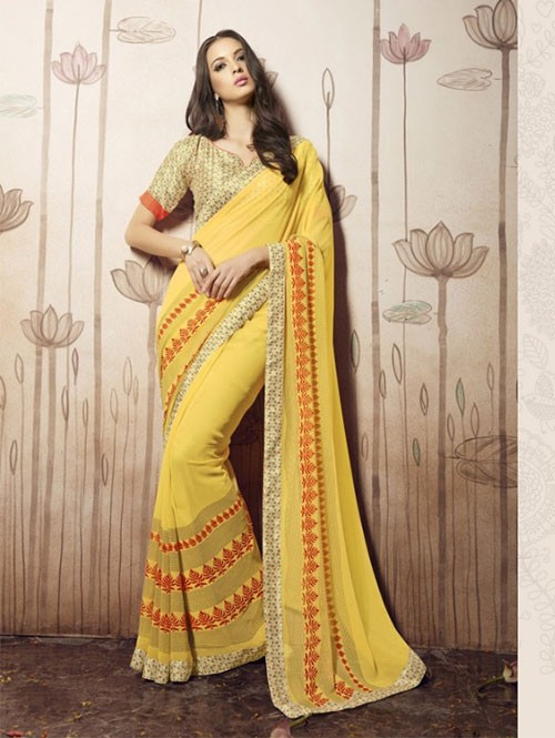Yellow Colored Beautiful Faux Georgette Saree with Printed Blouse.