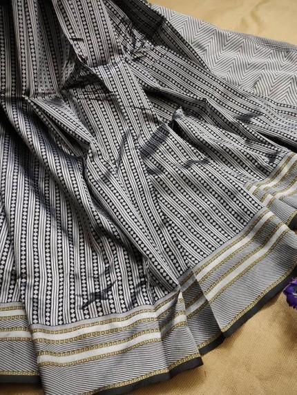 Black lichi silk saree with blouse piece