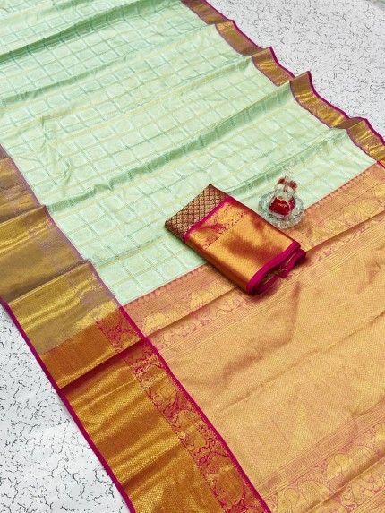 light green saree with pink border