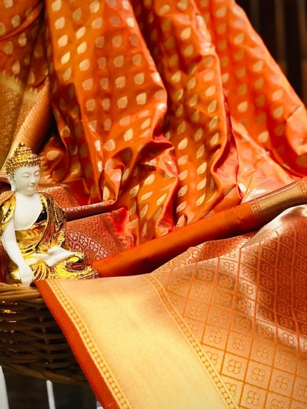 Orange coloured Lichi silk Party wear unique saree