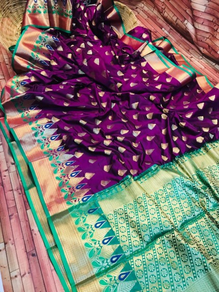 Purple coloured soft silk woven saree