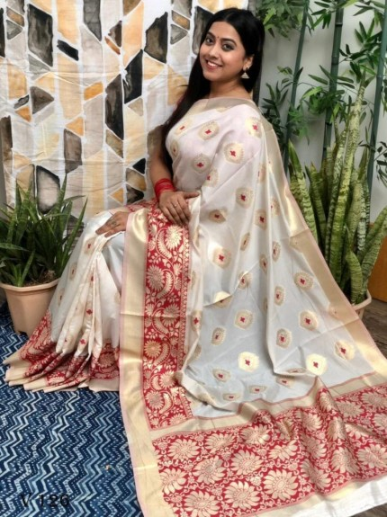 White coloured Katan silk saree with maroon coloured woven Border